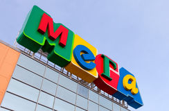 Sign shopping center Mega against blue sky Royalty Free Stock Image