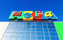 Sign shopping center Mega against the blue sky Royalty Free Stock Image