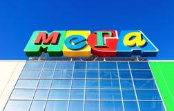 Sign shopping center Mega against the blue sky Royalty Free Stock Image