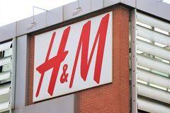 Sign and showcase of the famous clothing and underwear brand ` H&M` stock image