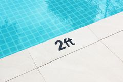 Sign Showing the Depth of the Pool. Stock Photos