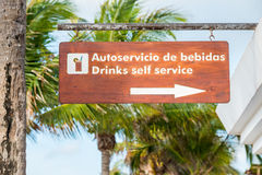 Sign showing direction to a self service bar  on a tropical resort (horizontal) Stock Images