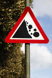 Sign showing falling rocks Stock Photography