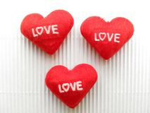 A sign showing heart embroidered red letters love Royalty Free Stock Photo