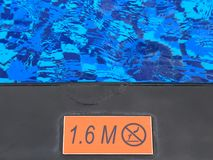 Sign showing 1.6 m depth and no diving warning Stock Photography