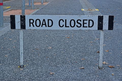 Sign showing road closed for a sealed car pathway into a building Royalty Free Stock Photo