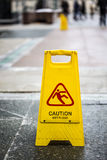 Sign showing warning of caution wet floor outdoors.  Royalty Free Stock Images