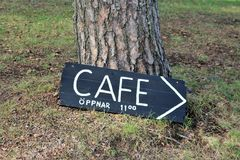 A sign that shows the way to a cafe royalty free stock image