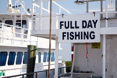 Sign on the side of a charter fishing boat