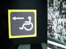 Sign sign for disabled on a black background Stock Photography