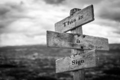 This is a sign signpost. Black and white, sign, quote, message, board concept stock photos