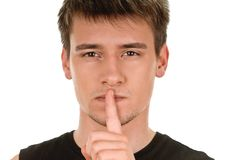 Man shows sign of silence Stock Photos