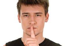 Man shows sign of silence Stock Photos