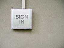 Sign in on silver banner. On wall Royalty Free Stock Photography