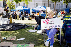 Sign By Sitting Participant At Occupy LA Royalty Free Stock Images