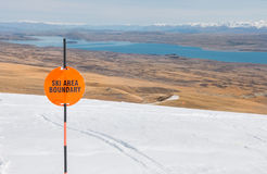 Sign Ski area boundary and view to a lake Stock Image