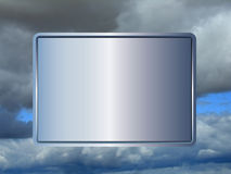 Sign in the sky 3. Blank sign with blue hue on blue and grey cloudy sky background Stock Photo