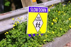 Sign slow down kids playing. The sign slow down kids playing stock photo