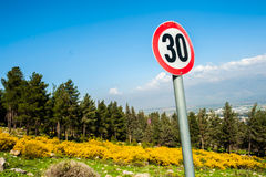 Sign slow down in the nature road royalty free stock photography