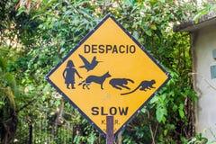 Sign slow in Manuel Antonio village, Costa Ri. Ca stock image