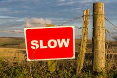Sign: Slow. In the evening light of Seaford Head Nature Reserve, near Cuckmere Haven, East Sussex, UK royalty free stock photos