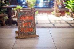 Sign at the small hotel-wet floor caution. See my other works in portfolio Royalty Free Stock Image