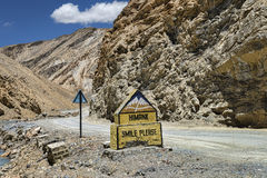Sign SMILE PLEASE nearby mountain road in Ladakh Stock Photography