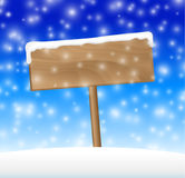 Sign on snow meadow with falling snow Royalty Free Stock Images