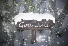 Sign Snowflakes Fir Tree God Jul Mean Merry Christmas. Wooden Christmas Sign With Snow And Fir Tree Branch In The Snowy Forest. Swedish Text God Jul Means Merry Royalty Free Stock Photos