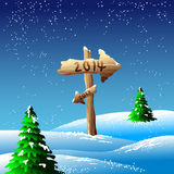 2014 sign in snowy landscape. Illustration of wooden sign pointing towards 2014 in snowing winters landscape Royalty Free Stock Photo