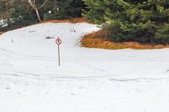 Sign forbids skiing. Sign on snowy track forbids skiing royalty free stock photos