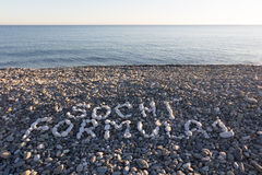 The sign Sochi Formula 1 made from white pebbles on pebble beach. On the sea Royalty Free Stock Images