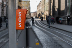 Sign SOS on the pole. Road traffic background.  Royalty Free Stock Photos