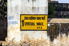 Sign spiritual walk at the wall. The sign spiritual walk assists the tourists by understanding which way to walk around the religious places Royalty Free Stock Image