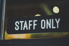 Sign `Staff only` hang on door royalty free stock photography