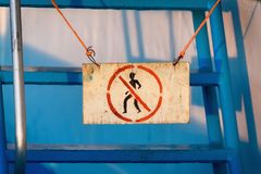 A sign on the stairs forbids everyone to climb the stairs. A sign on the stairs forbids everyone to climb the stairs stock photography