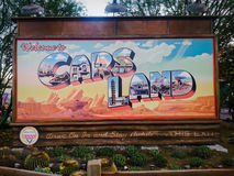 Sign states Welcome to Cars Land at Disney. Billboard sign inside Disney's California Adventure stating Welcome to Cars Land surrounded by trees and cacti. Cars stock image