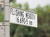 Sign stating distance from sign to Flushing Meadow in New York Stock Images