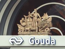 Entrance of Central Trainstation Gouda. Sign and statue above entrance of the central trainstation Gouda Stock Photo
