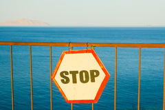 Sign Stop installed on a sandy beach Stock Photos