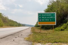 Sign on the Street at Border to the Guantanamo province, Cuba. Sign on the Street and Landscape at Border to the Guantanamo province, Cuba Royalty Free Stock Photography