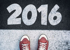 2016 sign. Student standing above the sign for New Year 2016 royalty free stock images