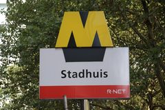 Sign of the subway in Rotterdam at metro station Stadhuis, city hall in English as part of R-Net transport system.  royalty free stock image
