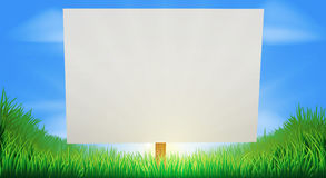 Sign in sunny grass field Royalty Free Stock Photo