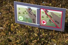 Stay On Trail Hiking Sign in Canadian Rockies. Sign in Sunshine Meadows Natural Wilderness Area asking Hikers to Please stay on established Hiking Trail.  Banff Royalty Free Stock Photo