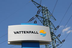 Sign of the Swedish power company Vattenfall and  transmission tower in the background Royalty Free Stock Image
