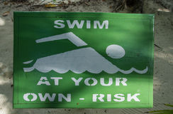 The sign Swim at your own risk Royalty Free Stock Photography
