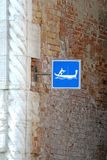 Sign with symbol of passing gondolas in a canal in Venice Royalty Free Stock Photography