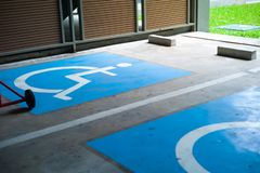 Sign and symbol of priority parking lots for the disable people royalty free stock photos