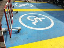 Sign and symbol of reserved parking area for disabled person and. Family with baby stroller on the ground Stock Images